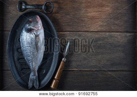 Fresh Whole Sea Fish On Iron Rustic Pan,cooking Concept