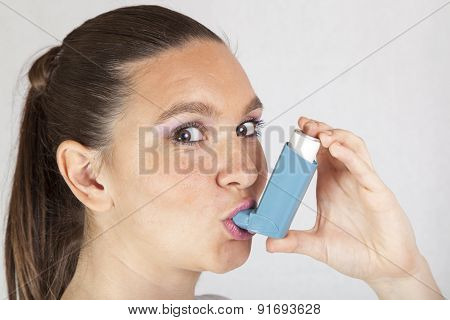 Pretty girl with asthma inhaler