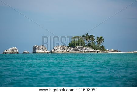 Indonesia, small island with palm trees