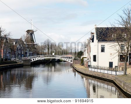 NETHERLANDS - DOKKUM - CIRCA APRIL 2015: Port of Dokkum with the old mill.