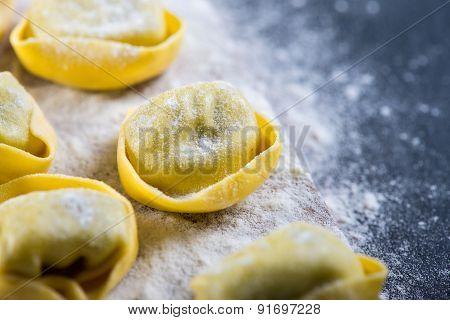 Preparation Of Ravioli Pasta On Black Slate Background