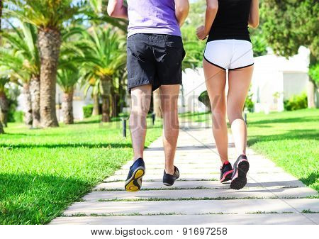 Rear View Of Caucasian Female And Male Runners