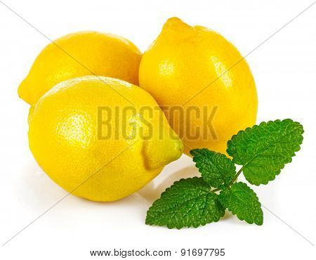 Fresh lemons with leaves melissa. Isolated on white background