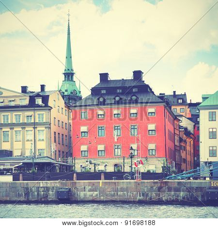 Waterfront in the Old Town of Stockholm. Retro style filtred image