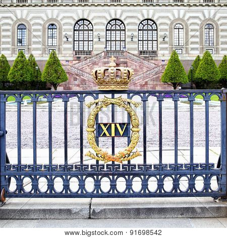 The fence of Stockholm Royal Palace with crown