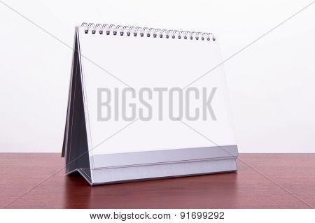 Desk Calendar On Table
