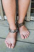 stock photo of interpreter  - Child was gets foot interpreter by the chains  - JPG