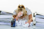 stock photo of overwhelming  - young woman in office is overwhelmed with work - JPG