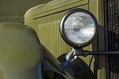 stock photo of khakis  - forward part of the retro military car with a headlight closeup of khaki color - JPG