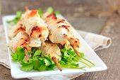 stock photo of chicken  - Chicken fillet barbecue on wodden skewers with yogurt parsley and garlic - JPG