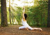 picture of king  - Yoga one legged king pigeon pose in the forest nature - JPG