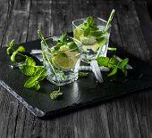 image of mojito  - Drink mojito in a glasses over black background - JPG
