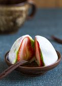 picture of fillies  - Daifuku with strawberry and green tea filliing by a cup of tea  - JPG
