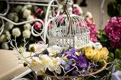 pic of caged  - decorative flowers in retro vintage bird cage - JPG