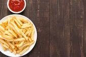 stock photo of high calorie foods  - French fries with ketchup on wooden background - JPG