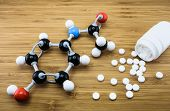stock photo of paracetamol  - Molecule structure of paracetamol drug with a bottle and pills on wood background - JPG