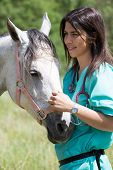 picture of veterinary  - Veterinary great performing a scan to a young mare - JPG