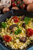 image of scrambled eggs  - healthy breakfastfrying scramble eggs and grilled vegetables - JPG