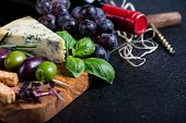 pic of cheese platter  - Food backgroundrustic board with cheese herbs and wine - JPG