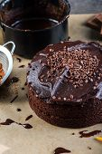picture of tort  - homemade chocolate torte cake on baking paper  - JPG