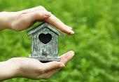 foto of nesting box  - Decorative nesting box in female hands on bright background - JPG