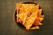 stock photo of nachos  - Tasty nachos in color bowl - JPG