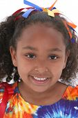 image of close-up shot  - Close up of beautiful six year old girl in bright colors - JPG