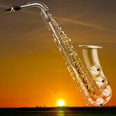 picture of saxophones  - abstract night golden background with city and saxophone - JPG