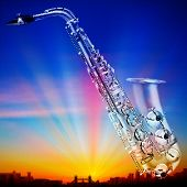 picture of saxophones  - abstract sunrise background with silhouette of london and saxophone - JPG