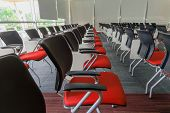 picture of training room  - Many dark red chairs arranged neatly in a training room - JPG