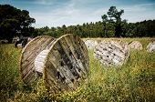 foto of battle  - Abandoned electric cable reels in a paintball battle field - JPG