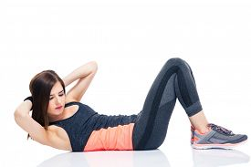 foto of abdominal  - Young woman making abdominal exercises isolated on a white background - JPG