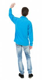 stock photo of waving hands  - Back view of handsome man greeting waving from his hands - JPG