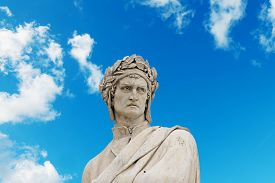 picture of alighieri  - dante alighieri statue under a blue sky with clouds - JPG