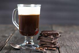 foto of irish  - alcoholic irish coffee with dark chocolate and caffee beans - JPG