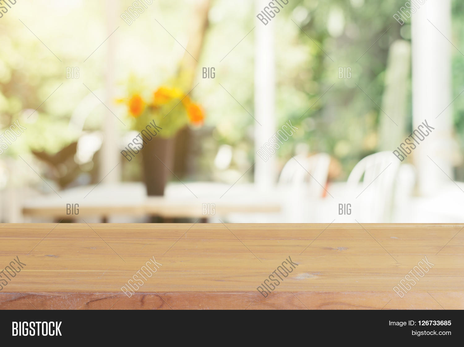 Empty wood table and blurred living room background stock photo - Wooden Board Empty Table Blurred Background Perspective Brown Wood Over Blur Flower Vase In Coffee