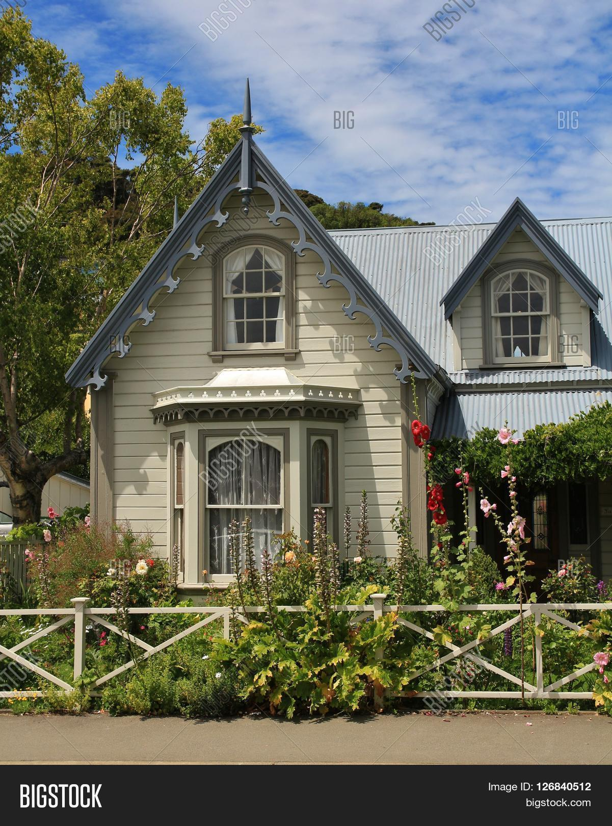 old house in akaroa. beautiful small house with flowers in the