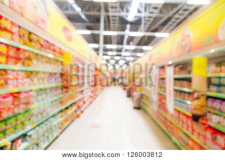 Defocused Brightly Lit Colourful Grocery Aisle In A Modern Hypermarket