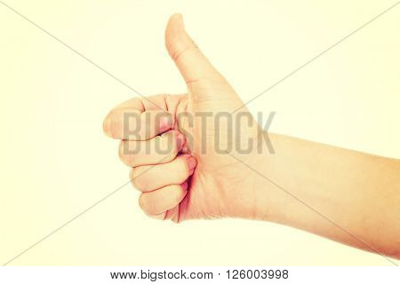 Woman's hand showing thumb up