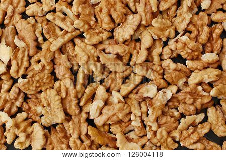 Background From Walnuts On The Black Background