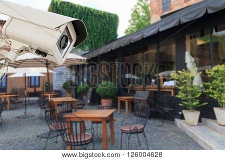 The CCTV Security Camera operating in the restaurant blur background.