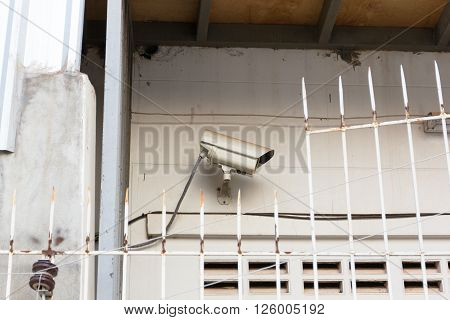 The Old CCTV Security Camera operating long time on wall, CCTV Camera concept, CCTV Camera background, CCTV Camera idea, CCTV Camera copy space, CCTV Camera video.