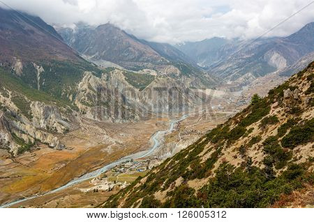 River flowing through a mountain valley in Nepal. Annapurna circuit trek.