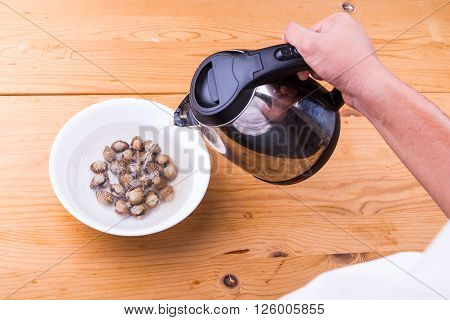 Cockles are cooked by pouring boiling water over it