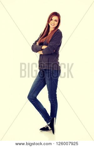 Happy teen woman with folded arms