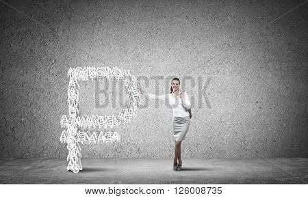 Young confident businesswoman leaning on big rouble sign
