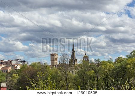 Park of the river Ebro with Logroño skyline (Santa Maria de Palacio and San Bartolome belltowers) in background. La Rioja. Spain.