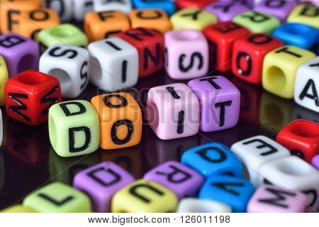 Do it surrounding by colorful alphabets dice