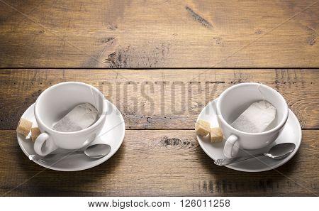 Preparation for brewing tea.Set of two ceramic tea mugs with sachet.
