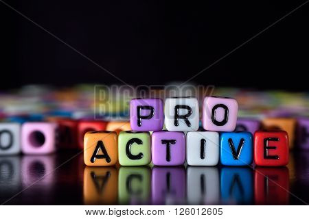 Pro active word with reflection on colorful dice